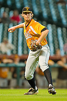 Starting pitcher Drew Steckenrider #20 of the Tennessee Volunteers makes a throw to first base against the Houston Cougars at Minute Maid Park on March 2, 2012 in Houston, Texas.  The Cougars defeated the Volunteers 7-4.  Brian Westerholt / Four Seam Images