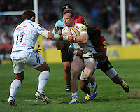James Short of Exeter Chiefs is tackled by Marland Yarde of Harlequins during the Aviva Premiership match between Harlequins and Exeter Chiefs at The Twickenham Stoop on Saturday 7th May 2016 (Photo: Rob Munro/Stewart Communications)