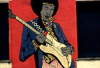 Milano 1977.Murales realizzati in Largo Murani da un gruppo di giovani della sinistra alternativa su temi di carattere sociale. .Foto Livio Senigalliesi