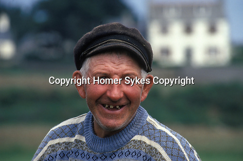 Senior French man with bad teeth, gap tooth smile. St Malo Brittany France  1990s
