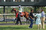 August 29, 2015. Divining Rod, Alex Cintron up, circles the walking ring before the Grade III Smarty Jones Stakes; at right are his owners, Roy and Gretchen Jackson. Parx racing in Bensalem, PA.  (Joan Fairman Kanes/ESW/CSM)