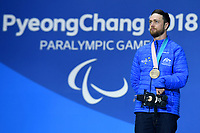 Day 7 / Snowboard banked SL. / Simon Patmore Bronze Medalist<br /> PyeongChang 2018 Paralympic Games<br /> Australian Paralympic Committee<br /> PyeongChang South Korea<br /> Friday March 16th 2018<br /> © Sport the library / Jeff Crow