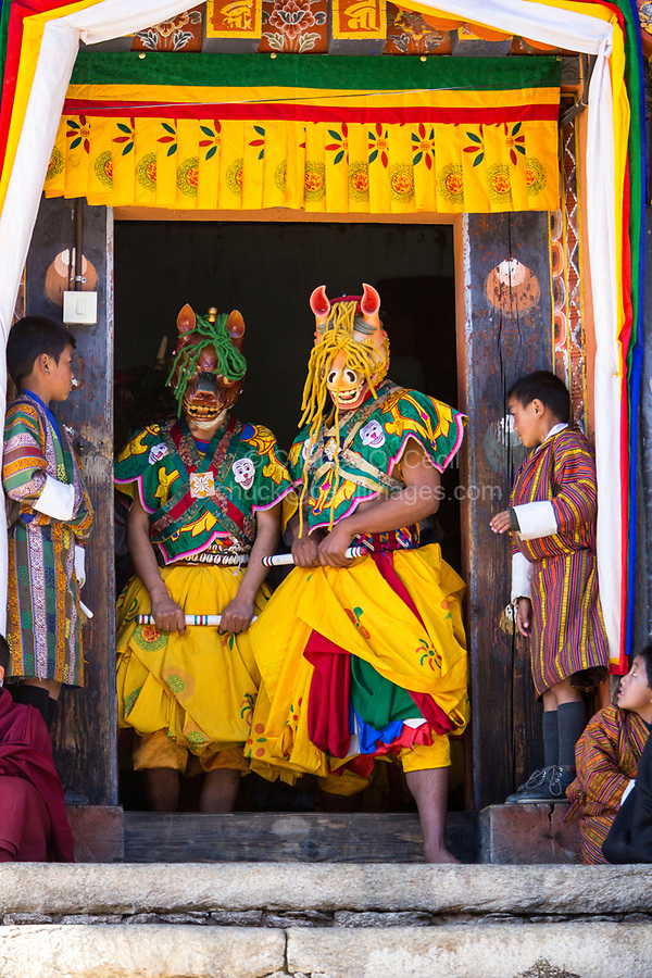 Prakhar Lhakhang, Bumthang, Bhutan.  Buddhist Monks Emerging from the Monastery to Perform a Dance in the Duechoed Religious Festival.