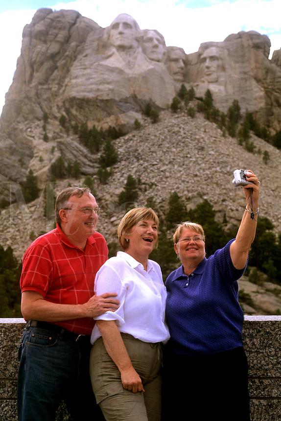 Family taking pictures at famous landmark of Mount Rushmore National Memorial South Dakota
