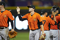 Preston Palmeiro (7) of the Frederick Keys high fives his teammates after their win over the Winston-Salem Dash at BB&T Ballpark on July 26, 2018 in Winston-Salem, North Carolina. The Keys defeated the Dash 6-1. (Brian Westerholt/Four Seam Images)