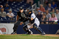 Trenton Thunder catcher Francisco Arcia (18) fields a throw as umpire Umpire Greg Roemer looks on to make the call during an Eastern League game against the New Hampshire Fisher Cats on August 20, 2019 at Arm & Hammer Park in Trenton, New Jersey.  New Hampshire defeated Trenton 7-2.  (Mike Janes/Four Seam Images)