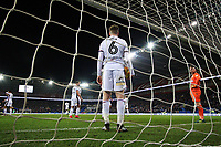 Josh Vela stands with ball in hand as he looks dejected with team mate Ben Alnwick of Bolton Wanderers as Sean Morrison of Cardiff City celebrates scoring his sides second goal of the match during the Sky Bet Championship match between Cardiff City and Bolton Wanderers at the Cardiff City Stadium, Cardiff, Wales, UK. Tuesday 13 February 2018