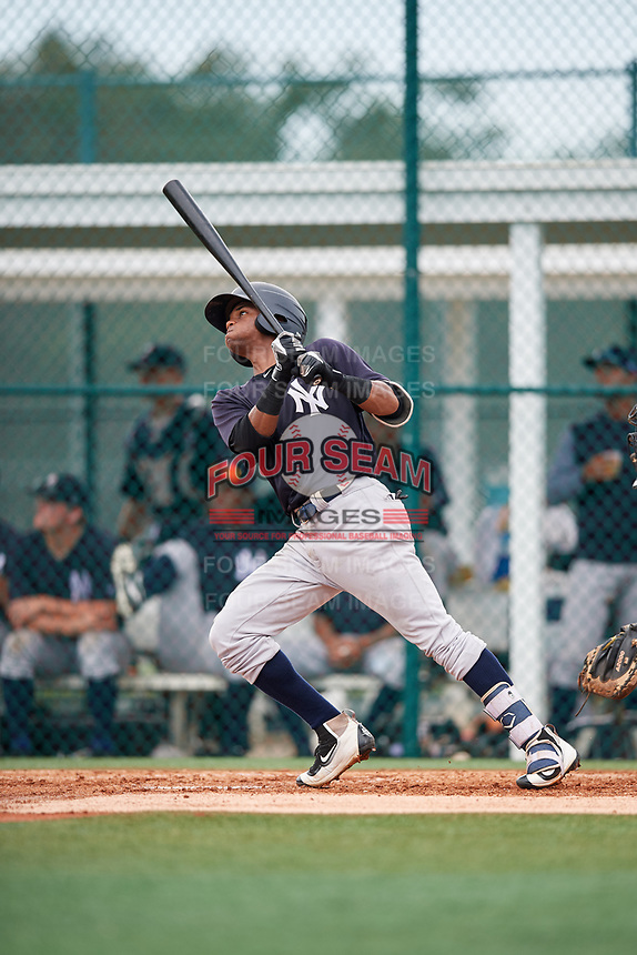 GCL Yankees East center fielder Sandy Mota (23) follows through on a swing during the second game of a doubleheader against the GCL Pirates on July 31, 2018 at Pirate City Complex in Bradenton, Florida.  GCL Pirates defeated GCL Yankees East 12-4.  (Mike Janes/Four Seam Images)