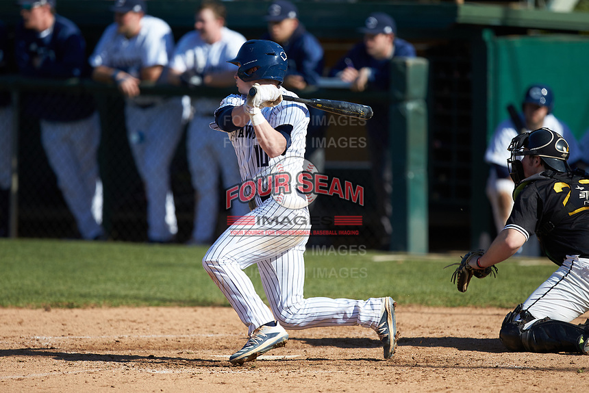 Joe Butts (10) of the Catawba Indians follows through on his swing against the West Virginia State Yellow Jackets at Newman Park on February 9, 2020 in Salisbury, North Carolina. The Indians defeated the Yellow Jackets 15-9 in game one of a doubleheader.  (Brian Westerholt/Four Seam Images)