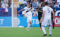 CARSON, CA - SEPTEMBER 29: Jonathan dos Santos #8 of the Los Angeles Galaxy crosses a ball during a game between Vancouver Whitecaps and Los Angeles Galaxy at Dignity Health Sports Park on September 29, 2019 in Carson, California.