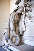 Picture and image of a mourning women  stone sculpture in the realistic borgeois style. The tomb of the Stefano family Tsculpted by by G Benetti 1877. The monumental tombs of the Staglieno Monumental Cemetery, Genoa, Italy