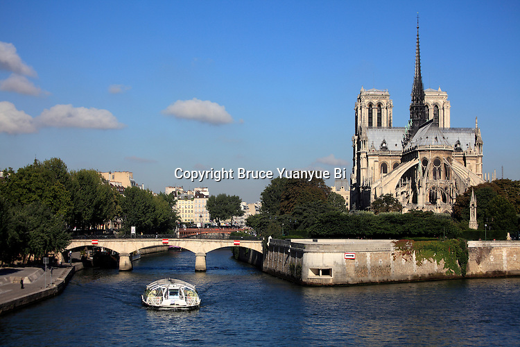 Tour boat in River Seine with Norte Dame Cathedral in background. city of Paris. Paris. France