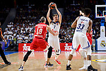 Real Madrid's Luka Doncic and Trey Thompkins and Crvena Zvezda Mts Belgrade's Marko Simonovic during Turkish Airlines Euroleague match between Real Madrid and Crvena Zvezda Mts Belgrade at Wizink Center in Madrid, Spain. March 10, 2017. (ALTERPHOTOS/BorjaB.Hojas)