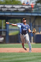 West Michigan Whitecaps third baseman Jordan Pearce (20) throws to first base during a game against the Quad Cities River Bandits on July 23, 2018 at Modern Woodmen Park in Davenport, Iowa.  Quad Cities defeated West Michigan 7-4.  (Mike Janes/Four Seam Images)