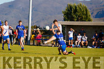 St Marys Tadhg O'Connor with a lovely curling ball splits the crossbar as Renard's Jim Sugrue tries to challenge.