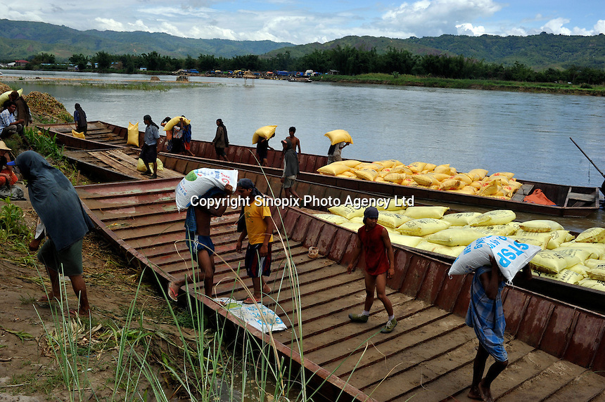 Goods are smuggled across the Shweli River, that seperates Burma and China, just outside Ruili. The area is a notorious for drugs that are smuggled into China by Chinese-Burmese gangs using drug mules. ...PHOTO BY SINOPIX