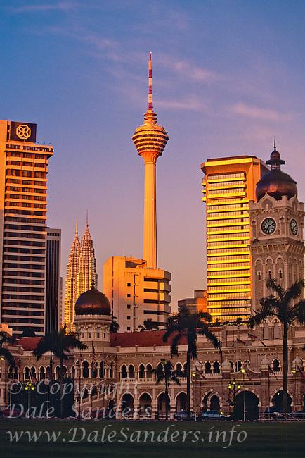 Sultan Abdul Amad building, Petronas Twin Towers, and the KL Tower from Dataran Merdeka.  Kuala Lumpur, Malaysia.