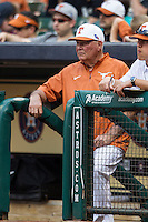 Texas Longhorns head coach Augie Garrido #16 in the dugout during the NCAA baseball game against the Houston Cougars on March 1, 2014 during the Houston College Classic at Minute Maid Park in Houston, Texas. The Longhorns defeated the Cougars 3-2. (Andrew Woolley/Four Seam Images)