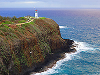Kilauea Point Lighthouse with seagulls along a rocky shore, Kaua'i.
