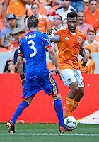 April 28, 2013: Houston Dynamo mid fielder Giles Barnes #23 and Colorado Rapids defender Drew Moor #3 during Major League Soccer match in Houston  TX. Houston Dynamo draw 1-1 against Colorado Rapids.