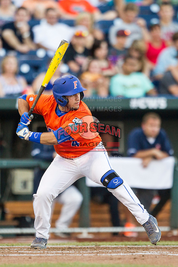 Florida Gators catcher Mike Rivera (4) at bat against the Virginia Cavaliers in Game 13 of the NCAA College World Series on June 20, 2015 at TD Ameritrade Park in Omaha, Nebraska. The Cavaliers beat the Gators 5-4. (Andrew Woolley/Four Seam Images)