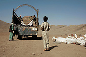 Kabul, Afghanistan<br /> November 21, 2001<br /> <br /> Dead foreign Taliban are lined up for burial in a cemetery outside of Kabul. They are each given a number, which was recorded in a photo with the body, and marked by that number at burial for identification.