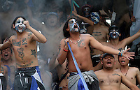 BOGOTA - COLOMBIA - 27-09-2015: Hinchas de  Millonarios  alientan a su equipo durante partido contra de Atletico Huila durante partido  por la fecha 14 de la Liga Aguila II 2015 jugado en el estadio Nemesio Camacho El Campin . / Fans of   Millonarios cheer their team against of Atletico Huila  during a match for the fourteenth date of the Liga Aguila II 2015 played at Nemesio Camacho El Campin stadium in Bogota  city. Photo: VizzorImage / Felipe Caicedo / Staff.