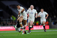 Anthony Watson of England is tackled by Mark Bennett of Scotland