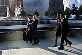 United States President Barack Obama and First Lady Michelle Obama, along with former U.S. President George W. Bush and former First Lady Laura Bush, walk along the North Memorial Pool of the National September 11 Memorial in New York, New York, on the tenth anniversary of the 9/11 attacks against the United States, Sunday, September 11, 2011. .Mandatory Credit: Pete Souza - White House via CNP