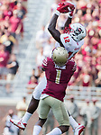 North Carolina State wide receiver Stephen Louis goes up for a long reception over Florida State defensive back Levant Taylor in the second half of an NCAA college football game in Tallahassee, Fla., Saturday, Sept. 23, 2017.  NC State defeated Florida State 27-21. (AP Photo/Mark Wallheiser)