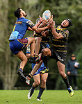 George Edwards of Howick (L) looks to take a high ball from James Watersonand  of Morgan Timoti-Cook of Northcote. Fox Memorial Rugby League, Northcote Tigers v Howick Hornets, Birkenhead War Memorial Park Auckland, Saturday 22nd July 2017. Photo: Simon Watts / www.bwmedia.co.nz
