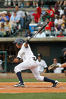 Charleston RiverDogs infielder Jose Javier (1) at bat during a game against the Augusta GreenJackets at Joseph P.Riley Jr. Ballpark on April 15, 2015 in Charleston, South Carolina. Charleston defeated Augusta 8-0. (Robert Gurganus/Four Seam Images)