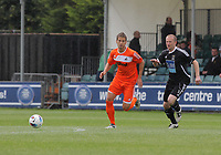Pictured L-R: Andrea Orlandi of Swansea marked by Adie Harris of Neath. Saturday 17 July 2011<br /> Re: Pre season friendly, Neath Football Club v Swansea City FC at the Gnoll ground, Neath, south Wales.