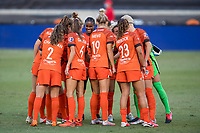 HOUSTON, TX - OCTOBER 04: The Houston Dash starting lineup huddles up before a game between North Carolina Courage and Houston Dash at BBVA Stadium on October 04, 2020 in Houston, Texas.