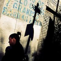 A Mexican woman walks around the street corner during a sunny morning in Buenavista, a neighborhood in Mexico City, Mexico, 29 October 2016.