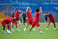 The United States Men's National stretches on the pitch of Estadio Mateo Flores in Guatemala City, Guatemala on Mon. June 11, 2012 during practice.  The USA will face Guatemala in a World Cup Qualifier on Tuesday.