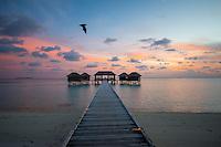 Maldives, Rangali Island. Conrad Hilton Resort. The spa at sunset.
