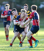 Saturday 4th February 2017 | RBAI vs BALLYCLARE HIGH SCHOOL<br /> <br /> Roy Chestnutt is tackled by Niall Armstrong during the Ulster Schools' Cup clash between RBAI and Ballyclare High School at  Cranmore Park, Belfast, Northern Ireland.<br /> <br /> Photograph by www.dicksondigital.com