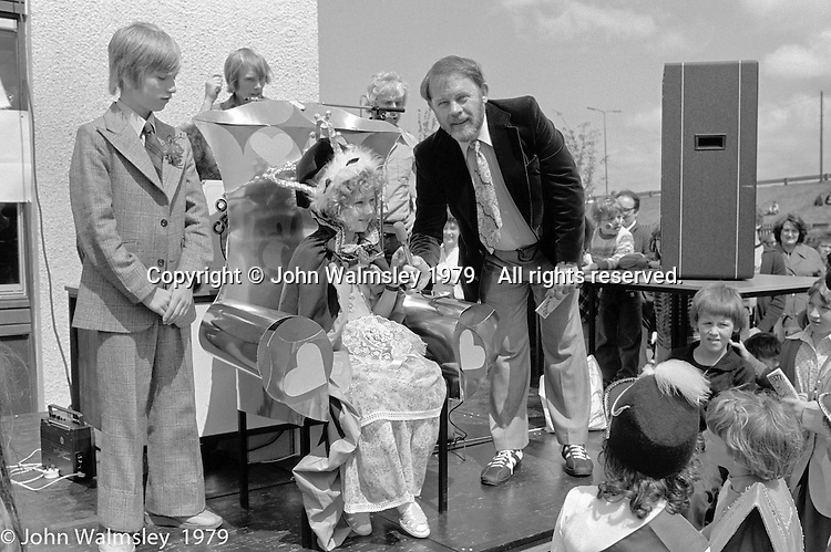 Ralph Wilson, Principal of the Wester Hailes Education Centre, interviewing the Gala Queen, Festival & Gala Day, Wester Hailes, Scotland, 1979.  John Walmsley was Photographer in Residence at the Education Centre for three weeks in 1979.  The Education Centre was, at the time, Scotland's largest purpose built community High School open all day every day for all ages from primary to adults.  The town of Wester Hailes, a few miles to the south west of Edinburgh, was built in the early 1970s mostly of blocks of flats and high rises.