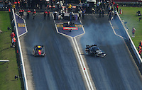 Apr. 28, 2012; Baytown, TX, USA: Aerial view of NHRA funny car driver Terry Haddock (right) loses traction and gets out of shape alongside Todd Simpson during qualifying for the Spring Nationals at Royal Purple Raceway. Mandatory Credit: Mark J. Rebilas-