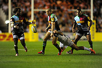 Mike Brown of Harlequins offloads to Marland Yarde of Harlequins as he is tackled during the Premiership Rugby Round 2 match between Harlequins and Saracens at The Twickenham Stoop on Friday 12th September 2014 (Photo by Rob Munro)