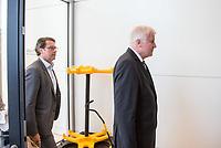 Bundesverkehrsminister Andreas Scheuer (links im Bild) und Innenminister Horst Seehofer (rechts), beide CSU, nach waehrend einer ausserordentlichen Sitzung der CDU/CSU-Fraktion nachdem es zwischen der CDU und der CSU zum Streit ueber den Umgang mit Fluechtlingen gab. Die Sitzung des Deutschen Bundestag wurde aufgrund dieses Streit auf Antrag der CDU/CSU-Fraktion fuer mehrere Stunden unterbrochen. Die Fraktionen von CDU und CSU tagten getrennt.<br /> 14.6.2018, Berlin<br /> Copyright: Christian-Ditsch.de<br /> [Inhaltsveraendernde Manipulation des Fotos nur nach ausdruecklicher Genehmigung des Fotografen. Vereinbarungen ueber Abtretung von Persoenlichkeitsrechten/Model Release der abgebildeten Person/Personen liegen nicht vor. NO MODEL RELEASE! Nur fuer Redaktionelle Zwecke. Don't publish without copyright Christian-Ditsch.de, Veroeffentlichung nur mit Fotografennennung, sowie gegen Honorar, MwSt. und Beleg. Konto: I N G - D i B a, IBAN DE58500105175400192269, BIC INGDDEFFXXX, Kontakt: post@christian-ditsch.de<br /> Bei der Bearbeitung der Dateiinformationen darf die Urheberkennzeichnung in den EXIF- und  IPTC-Daten nicht entfernt werden, diese sind in digitalen Medien nach ß95c UrhG rechtlich geschuetzt. Der Urhebervermerk wird gemaess ß13 UrhG verlangt.]