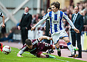 Killie's Chris Johnston gets away from Hearts' Calum Paterson.