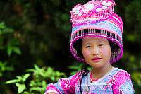 Portrait of Hmong tribe girl wearing traditional pink clothes at Wat Phra That temple in Doi Suthep mountains near Chiang Mai Thailand Southeast Asia