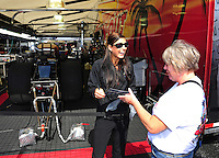 Sept. 30, 2011; Mohnton, PA, USA: NHRA funny car driver Leah Pruett (left) signs autographs during qualifying for the Auto Plus Nationals at Maple Grove Raceway. Mandatory Credit: Mark J. Rebilas-
