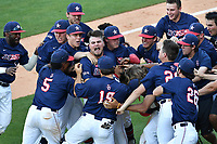Samford's Ayrton Schafer (13), hatless in the pile, shouts as he is swamped by teammates after he got the winning hit in the bottom of the ninth inning as No. 6 seed Samford beat No. 1 seed Mercer, 5-4, at the Southern Conference Baseball Championship on Friday, May 26, 2017, at Fluor Field at the West End in Greenville, South Carolina. (Tom Priddy/Four Seam Images)
