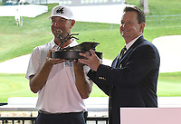 11th July 2021, Silvis, IL, USA; Tournament coordinator Lee Garlach presents Lucas Glover with the trophy for winning the John Deere Classic Golf tournament on July 11, 2021, at TPC Deere Run, Silvis, IL.