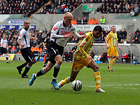 ATTENTION SPORTS PICTURE DESK<br /> Pictured L-R: David Cotterill of Swansea challenging Patrick Van Aanholt of Newcastle United<br /> Re: Coca Cola Championship, Swansea City Football Club v Newcastle United at the Liberty Stadium, Swansea, south Wales. 13 February 2010