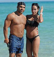 """SMG_FLXX_Melissa Gorga_Joe Gorga_Bikini_NYE_123111_13.JPG<br /> <br /> MIAMI BEACH, FL - DECEMBER 31: """"Real Housewives of New Jersey's"""" Melissa Gorga (sporting a sexy black two piece bikini) and her husband Joe share a kiss while playing in the water in South Beach.  on December 31, 2011 in Miami Beach, Florida  (Photo By Storms Media Group)  <br /> <br /> People:  Melissa Gorga_Joe Gorga<br /> <br /> Transmission Ref:  FLXX<br /> <br /> Must call if interested<br /> Michael Storms<br /> Storms Media Group Inc.<br /> 305-632-3400 - Cell<br /> 305-513-5783 - Fax<br /> MikeStorm@aol.com"""