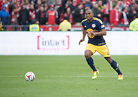 Toronto, Ontario - May 17, 2014: New York Red Bulls defender Jamison Olave #4 in action during a game between the New York Red Bulls and Toronto FC at BMO Field. Toronto FC won 2-0.